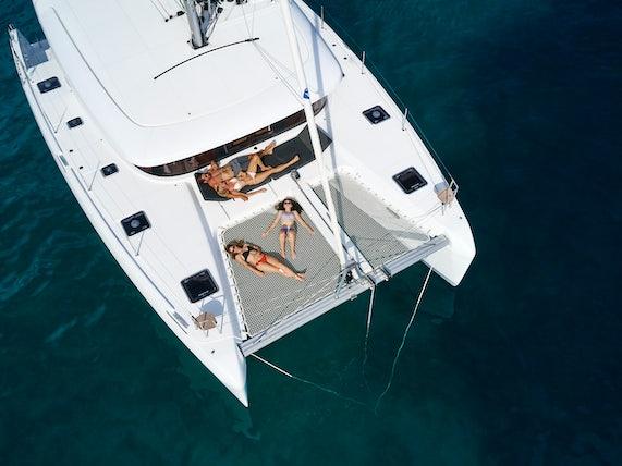Sunbathing on a catamaran